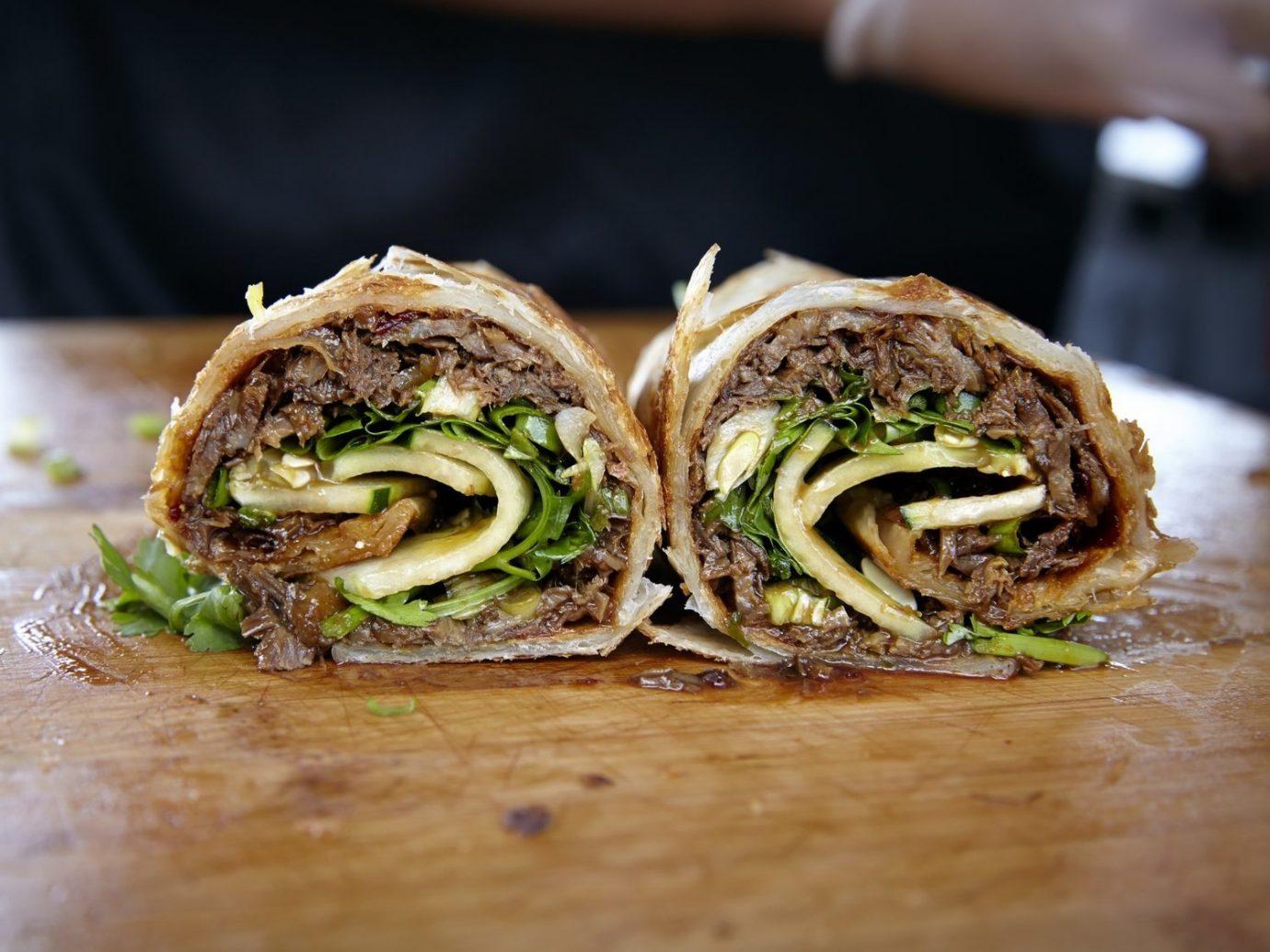 Budget Trip Ideas food dish sandwich produce cuisine vegetable half close meat
