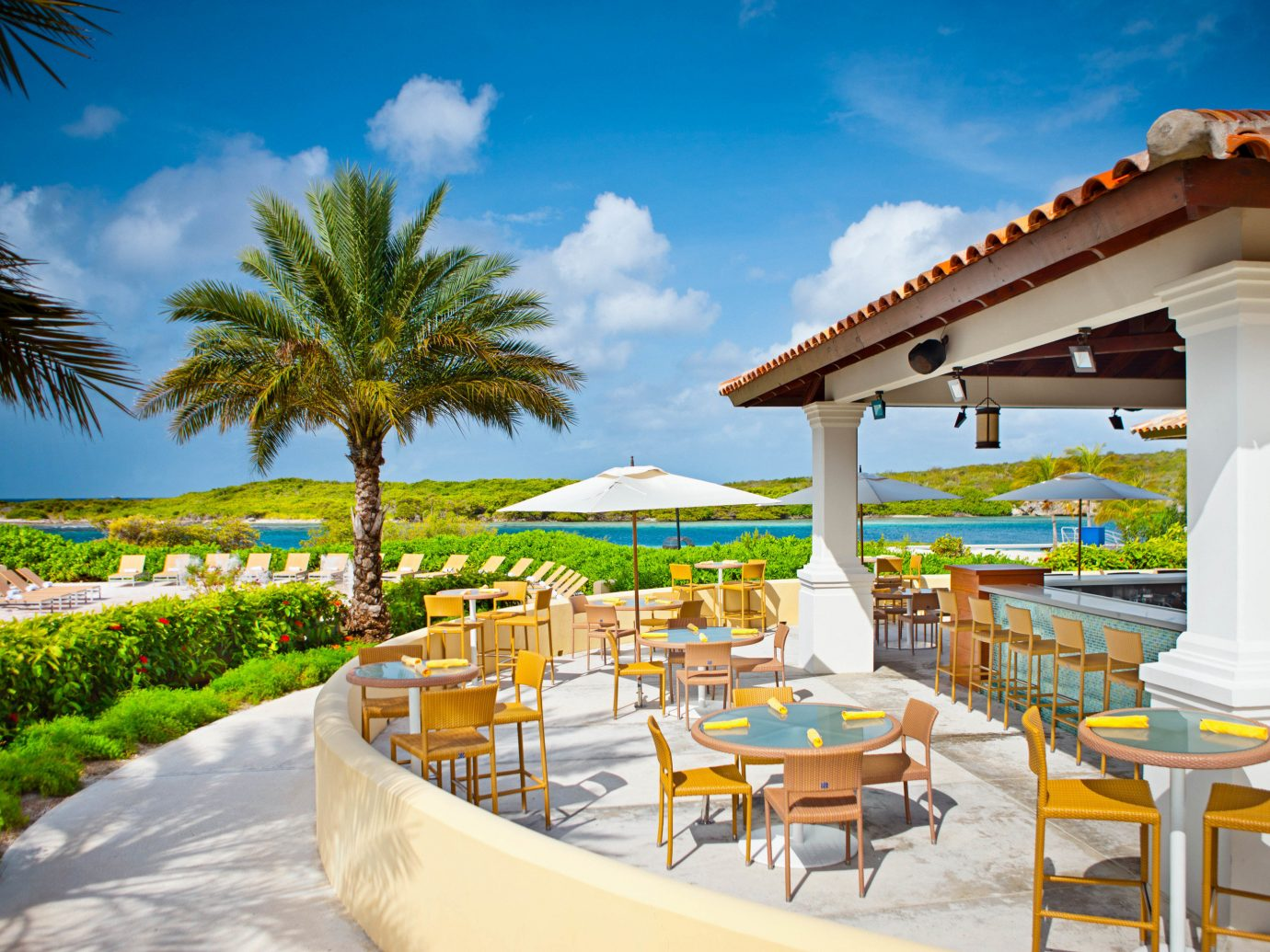Boutique Hotels Romantic Getaways Romantic Hotels tree sky outdoor Resort chair leisure vacation palm tree arecales real estate swimming pool estate tourism hotel resort town Villa tropics lawn palm furniture
