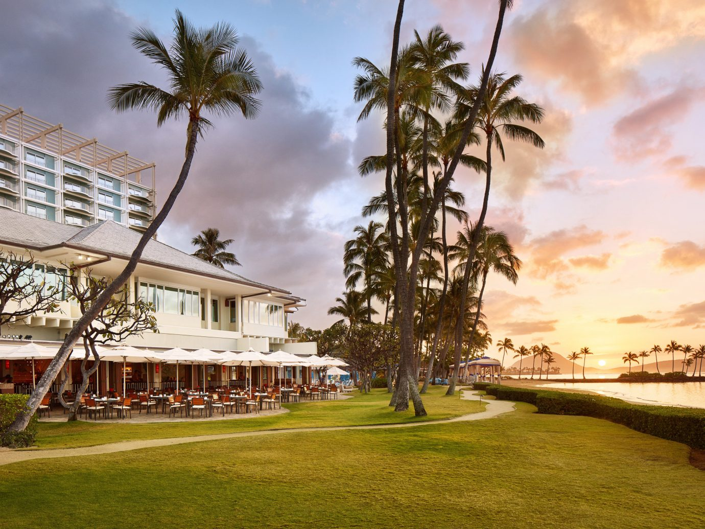 Boutique Hotels Hawaii Honolulu Hotels sky property Resort palm tree arecales real estate tree estate home tropics condominium vacation water plant cloud Sea house landscape leisure evening tourism hotel Ocean