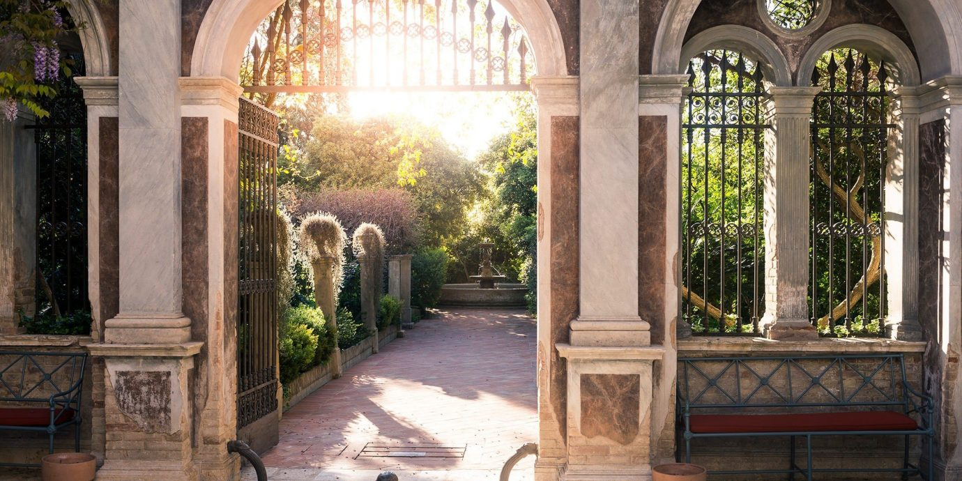 Jetsetter Guides building ground outdoor estate Courtyard arch Architecture stone mansion home hacienda window door wooden palace monastery ancient history chapel porch walkway furniture