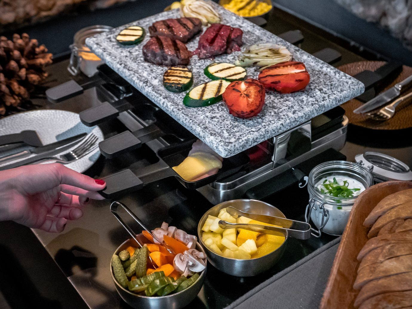 Food + Drink dish person meal indoor food grilling buffet cuisine meat barbecue brunch cooking sense lunch breakfast preparing