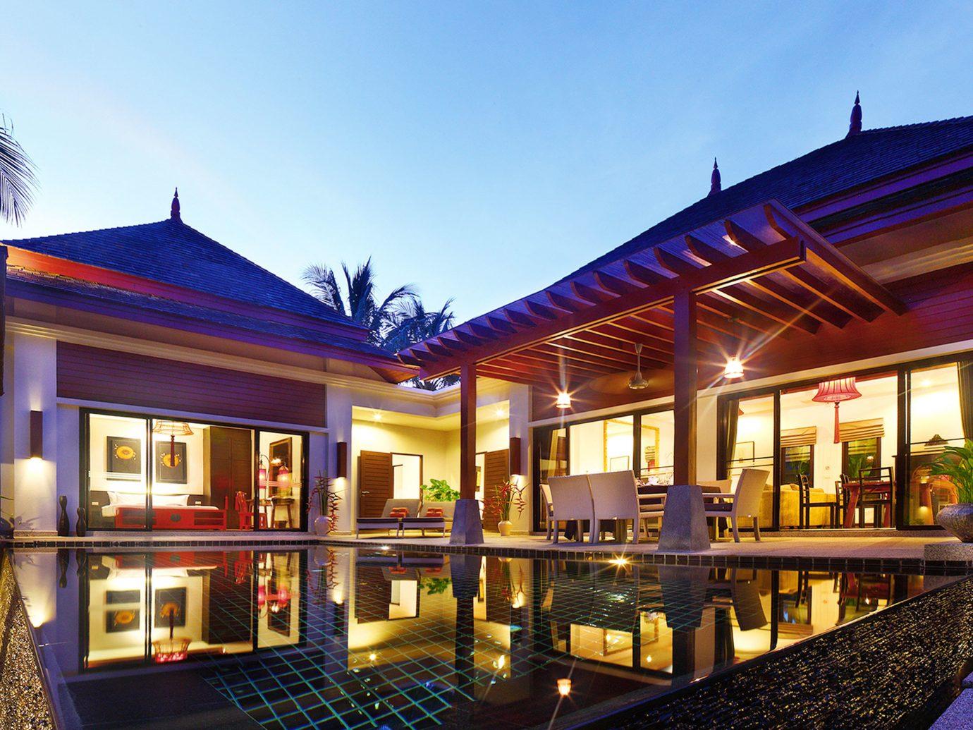 Elegant Hotels Jungle Patio Pool Tropical building sky outdoor property Resort estate house home real estate mansion condominium interior design facade restaurant Villa