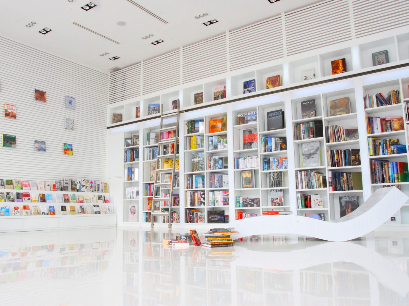 Beachfront Design Hotels Lounge Modern Tropical Waterfront indoor building public library library retail interior design shelf