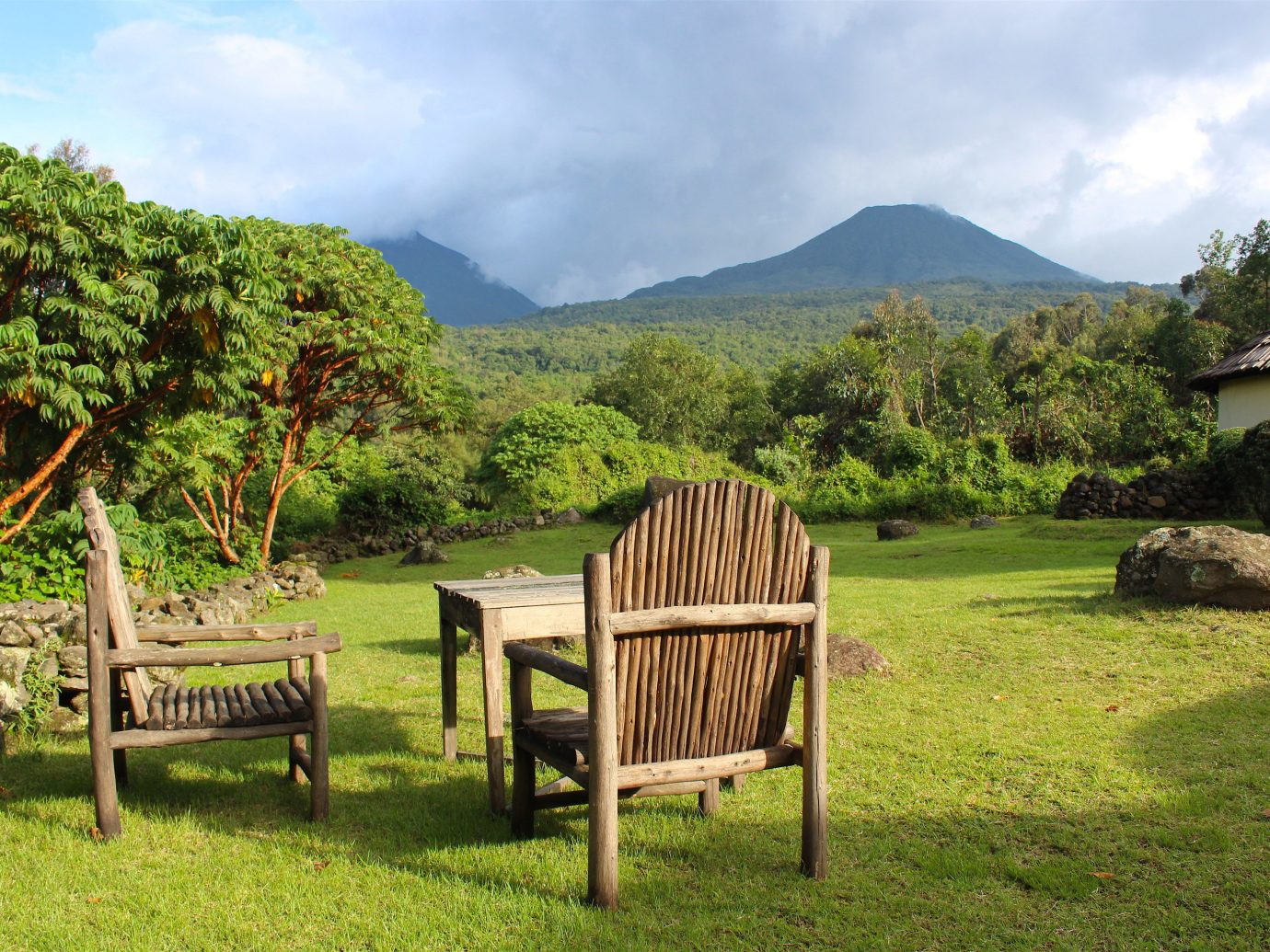 Adventure africa Off-the-beaten Path Trip Ideas grass outdoor sky mountain nature reserve property tree rural area wooden cottage real estate hill station landscape national park park hill plant Village hut land lot estate plantation leisure Jungle field cloud meadow lush
