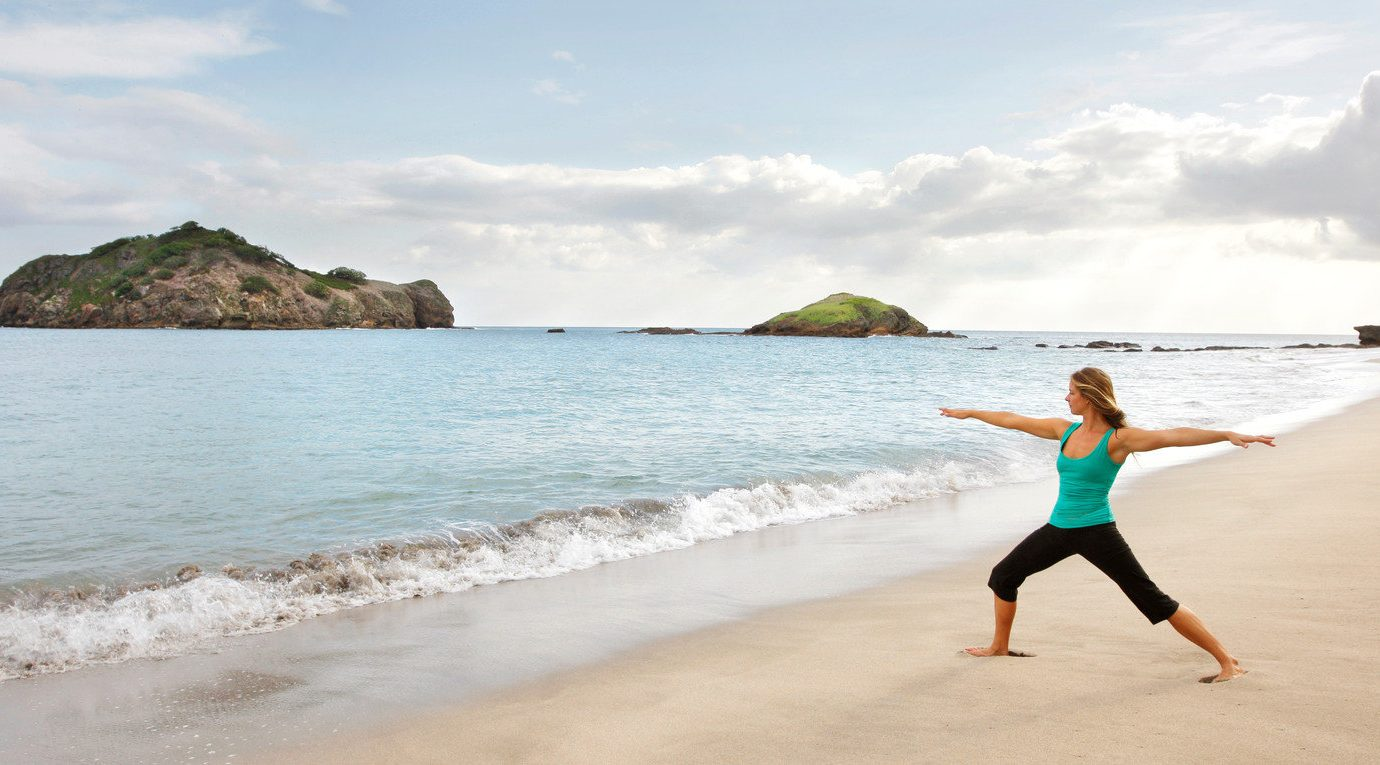 activities Beach calm Health + Wellness Hotels isolation Luxury meditation Ocean Outdoor Activities Outdoors people remote sand serene Spa Retreats Tropical white sands yoga sky outdoor water body of water shore Sea vacation Nature Coast wave bay