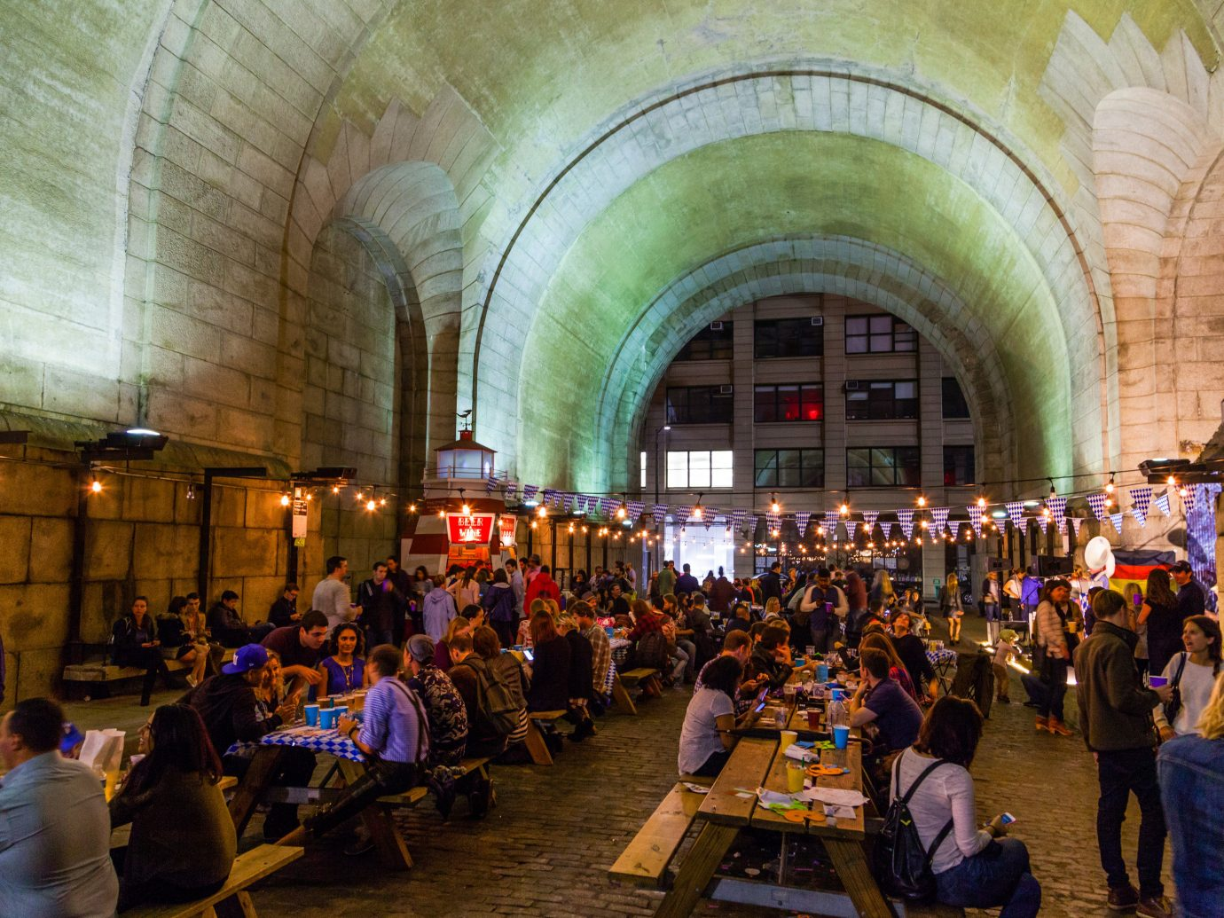Arts + Culture Fall Travel Festivals + Events person indoor people crowd tourist attraction City tourism bazaar building arch
