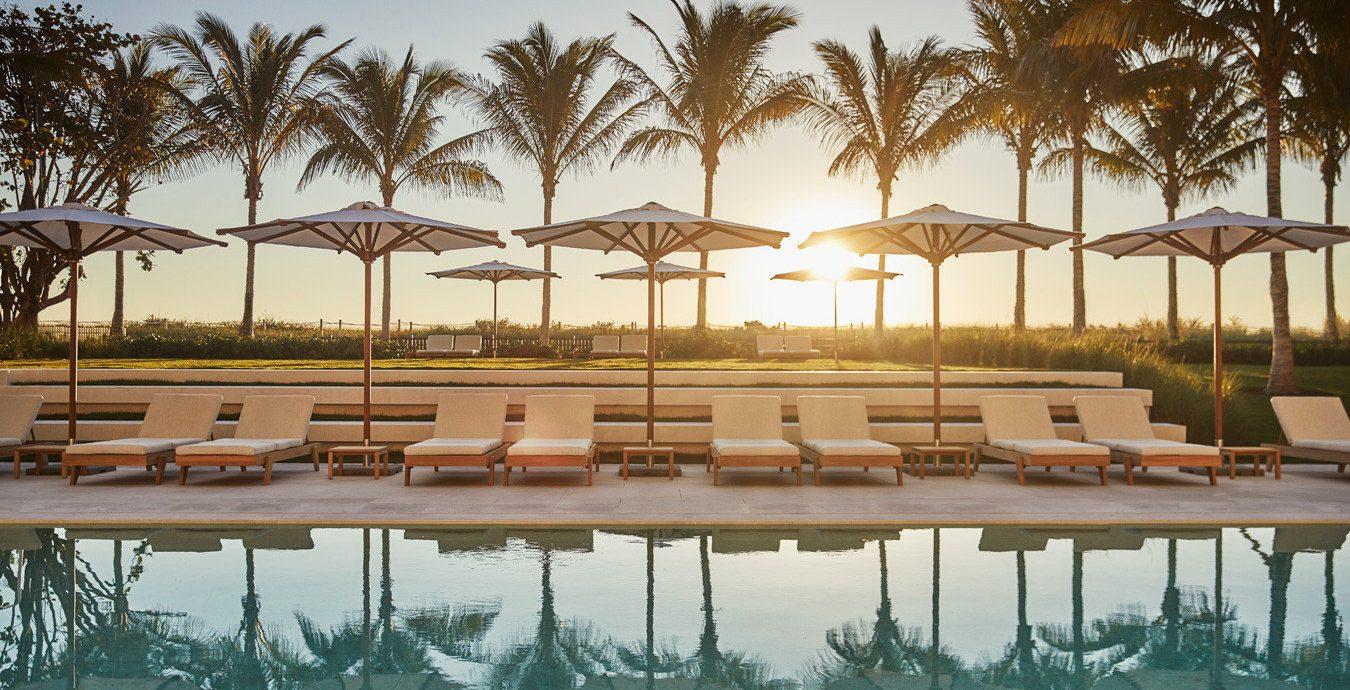 City Hotels Luxury Miami Miami Beach Trip Ideas Winter tree outdoor sky Beach row Resort swimming pool vacation reflection Ocean arecales dock marina Sea estate lined Lagoon bay long palm line
