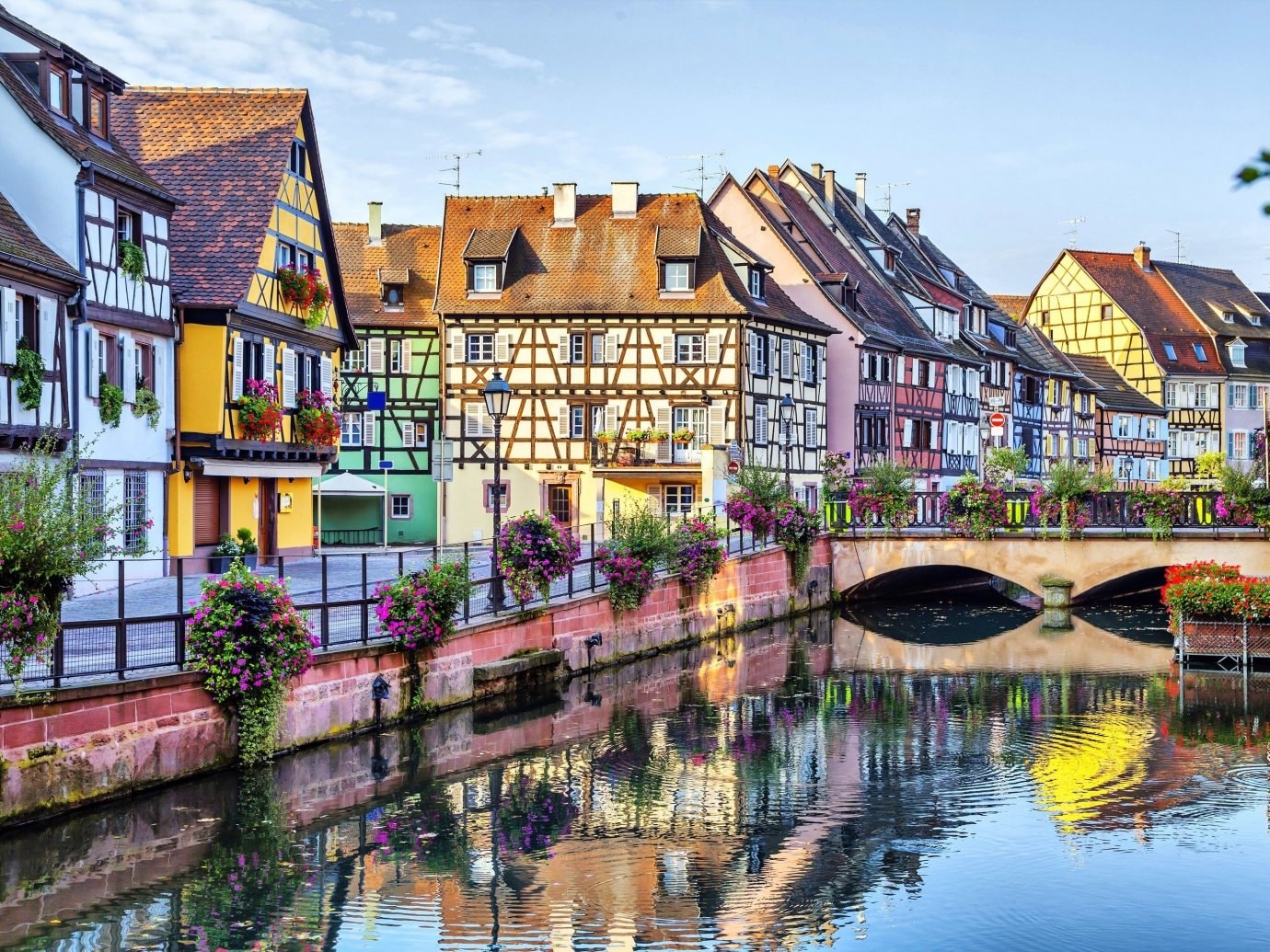 Offbeat building water outdoor Canal Town geographical feature landform body of water waterway cityscape house neighbourhood human settlement scene River vacation tourism Harbor Village flower several