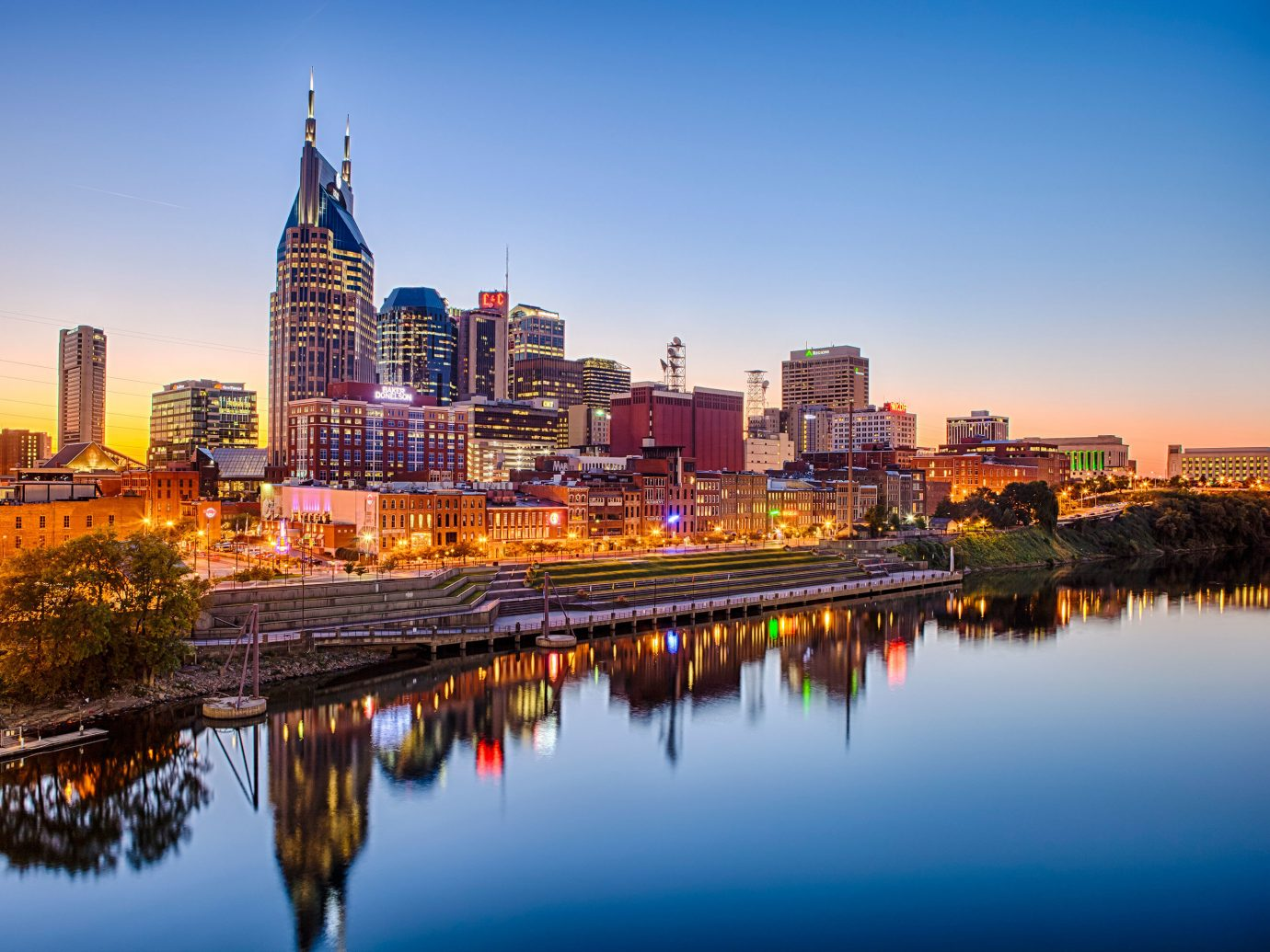 Boutique Hotels Hotels Trip Ideas water outdoor sky skyline reflection scene cityscape City geographical feature horizon landmark Harbor skyscraper human settlement urban area dusk evening River night morning metropolis Downtown Sunset dawn panorama