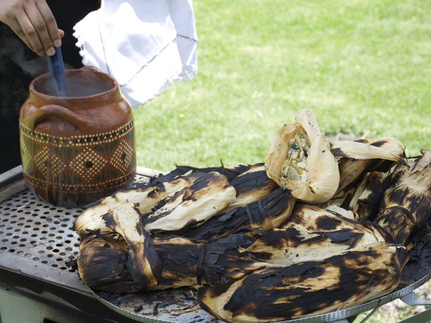 City corn Dining Eat food Food + Drink local eats Mexico City street food tamales Trip Ideas grass outdoor dish Seafood grill
