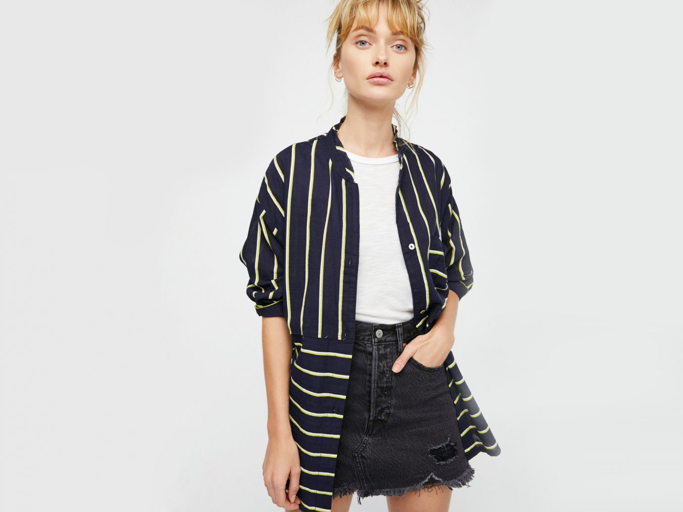Style + Design person clothing fashion model standing sleeve young outerwear posing fashion neck pattern t shirt girl shirt plaid fashion design dressed skirt