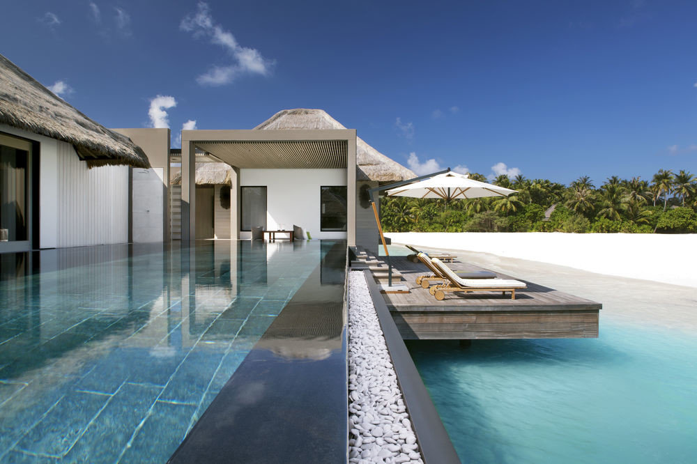 Hotels sky outdoor swimming pool property leisure house estate Resort Villa vacation home condominium real estate facade mansion stone Island