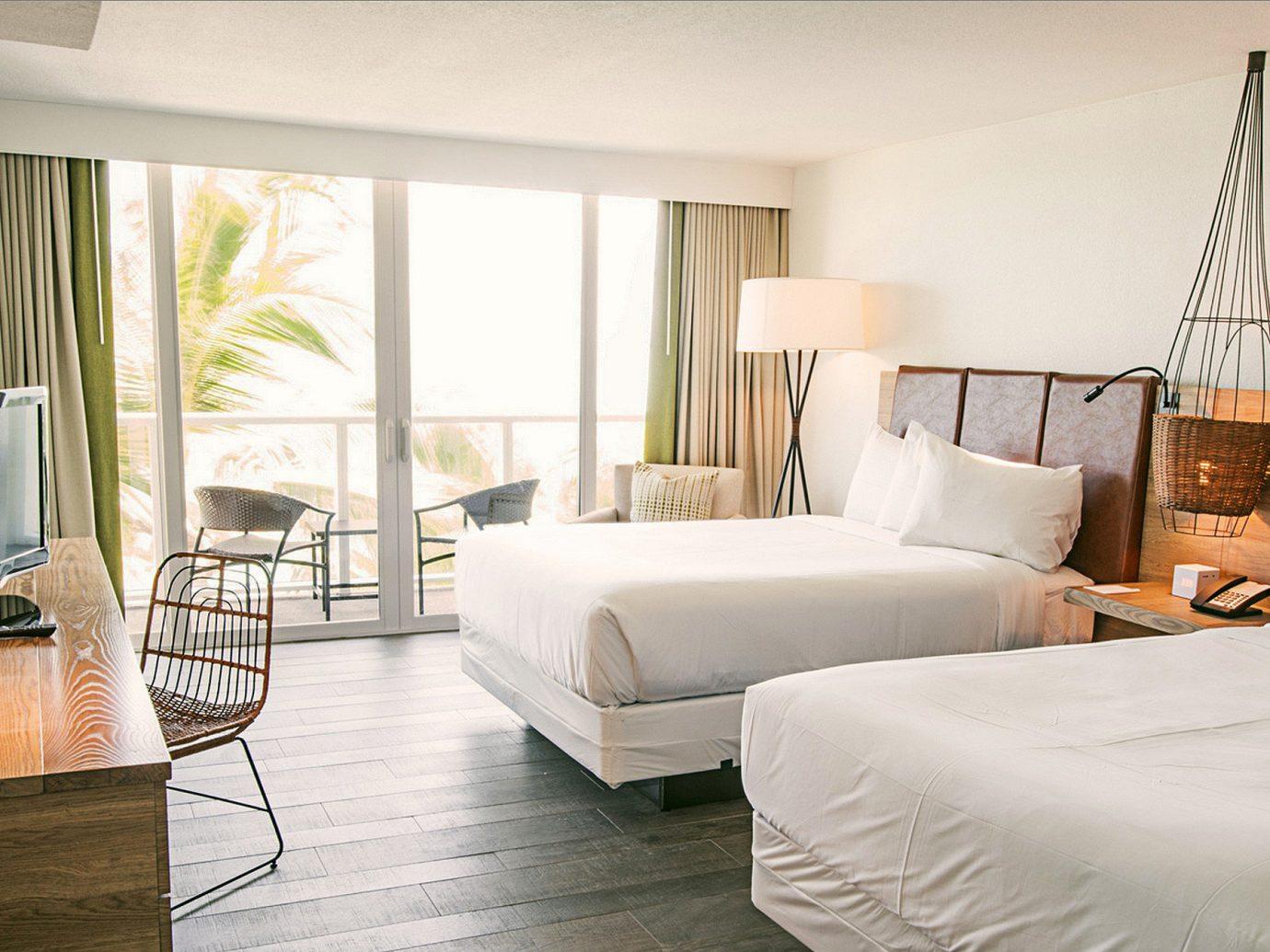 Beach Beachfront Bedroom Hotels Resort indoor bed floor wall room hotel property living room home Suite interior design estate condominium real estate furniture cottage apartment Villa