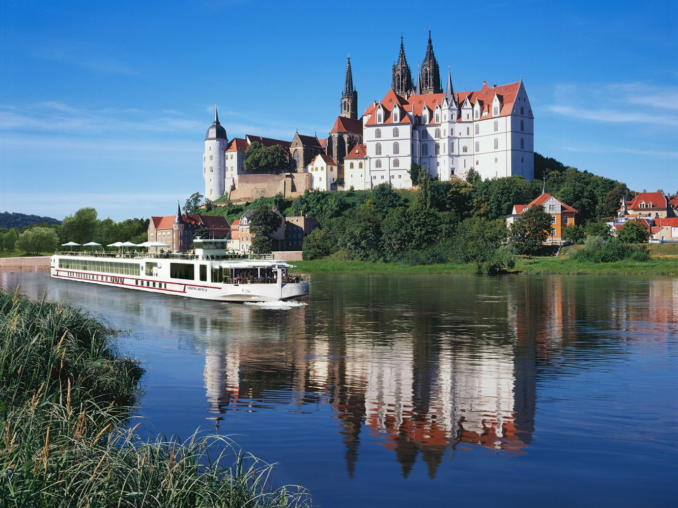 Cruise Travel Luxury Travel outdoor sky water reflection waterway River bank tree City plant house Canal Lake water castle tourist attraction fluvial landforms of streams watercourse château building evening reservoir landscape surrounded