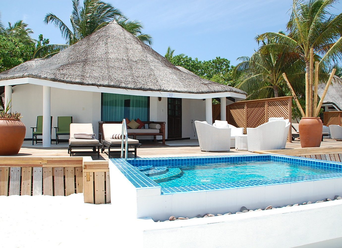Hotels tree sky outdoor swimming pool property leisure building Villa Resort vacation estate home backyard real estate cottage caribbean