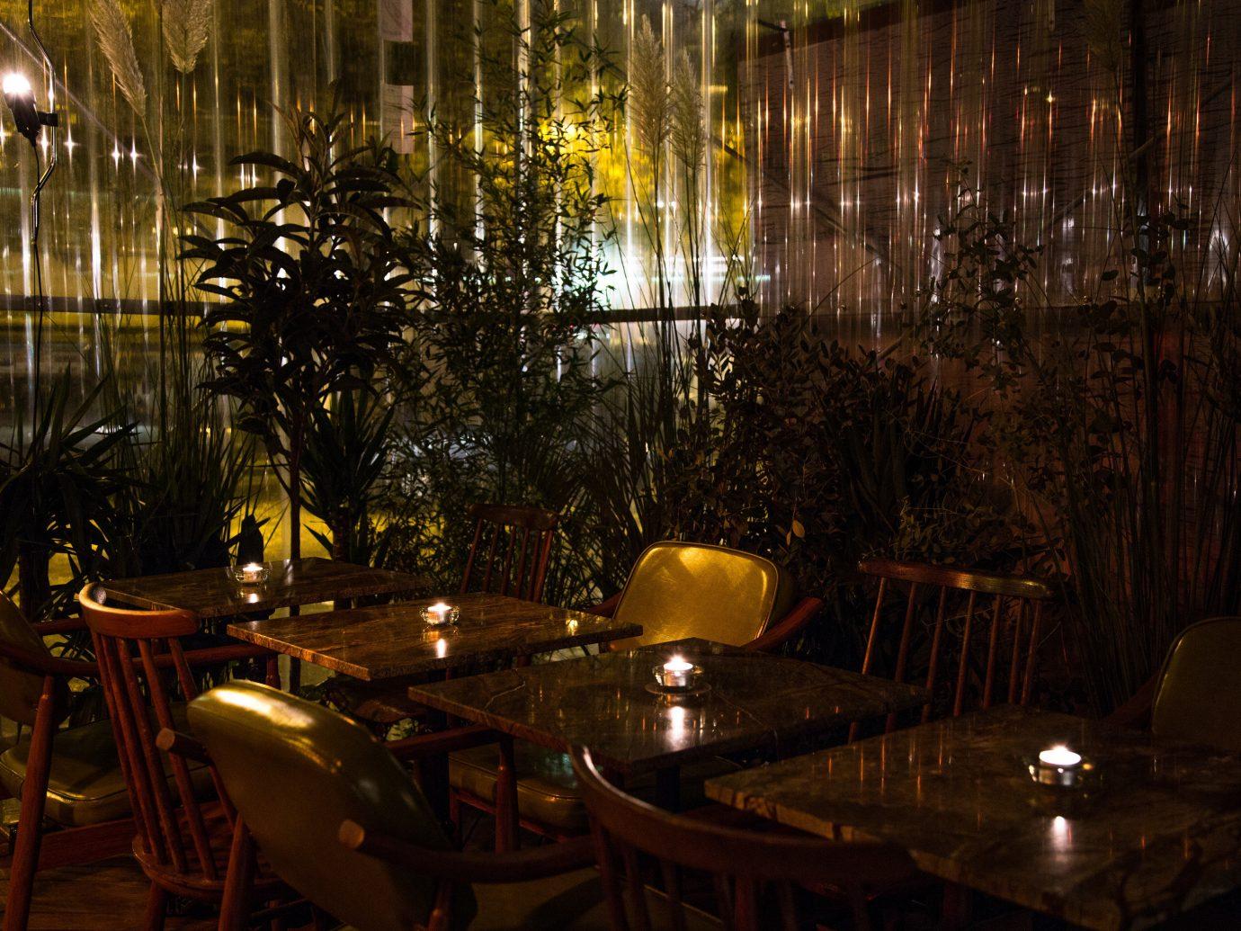 Food + Drink Luxury Travel News Style + Design Trip Ideas table lighting restaurant night plant tree interior design landscape lighting sunlight evening darkness reflection Resort dining table