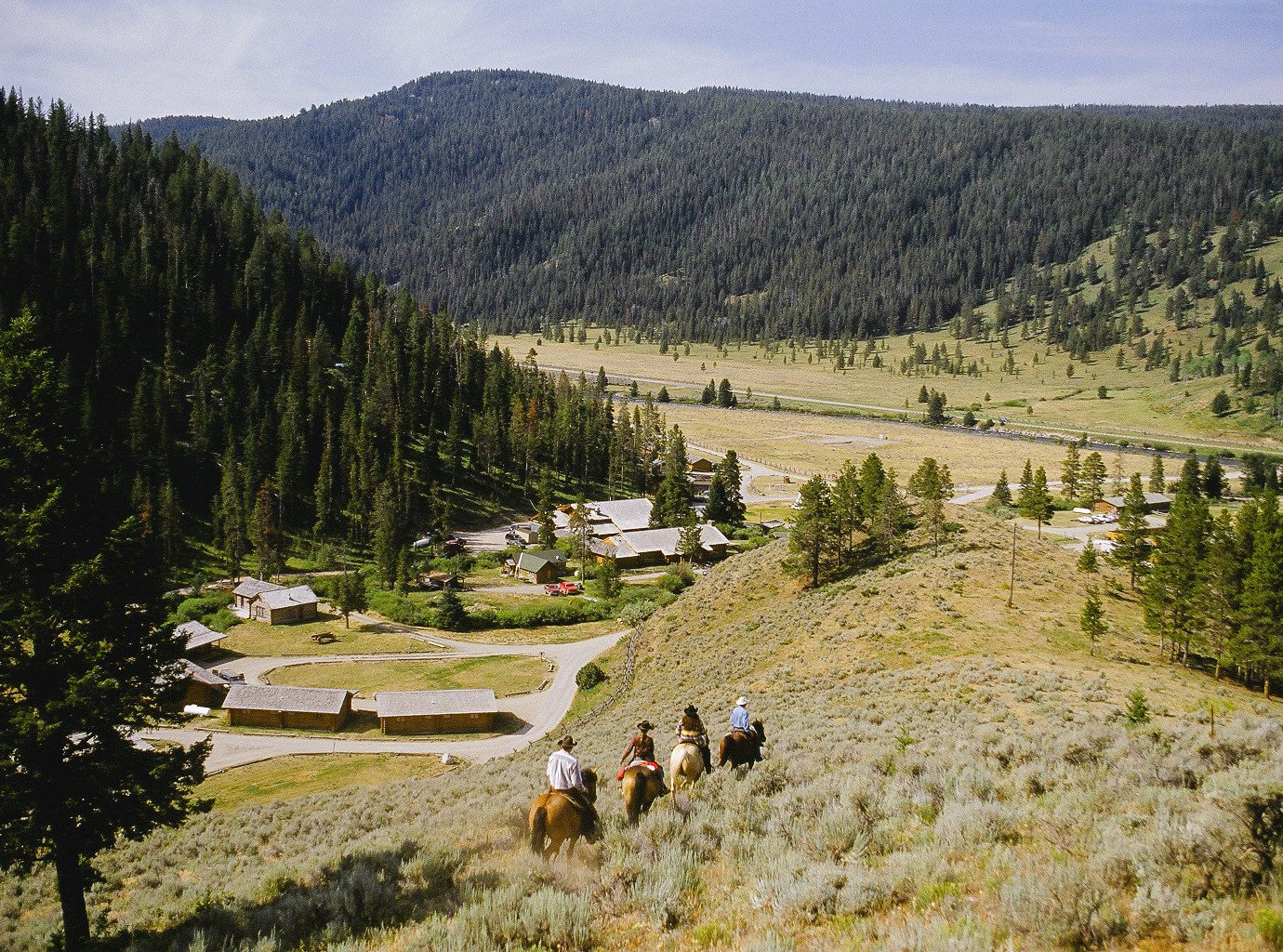 Glamping Hotels Montana Outdoors + Adventure Trip Ideas wilderness mountainous landforms mountain tree path valley mountain range biome trail national park landscape hill ridge meadow pasture continental divide mount scenery sky Ranch Forest temperate coniferous forest