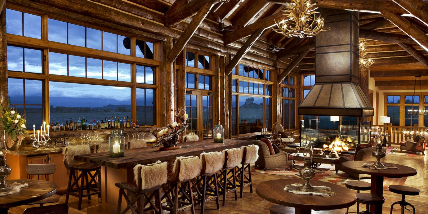Cabin calm cozy Dining extravagant Hotels isolation Lodge log cabin Lounge Luxury Mountains natural light Nature remote restaurant Rustic serene Trip Ideas view warm indoor table floor chair room estate ceiling Resort function hall meal interior design tavern palace Bar area several furniture dining room