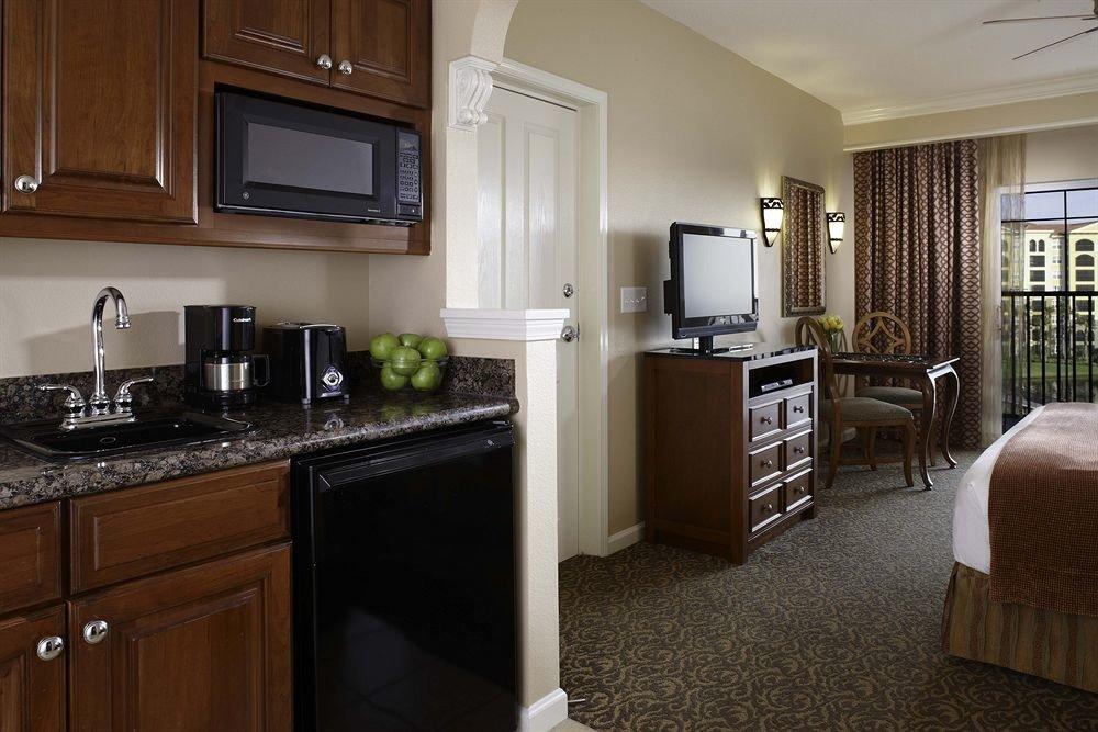 cabinet Kitchen property home cabinetry countertop hardwood cuisine classique cottage Suite flooring Modern