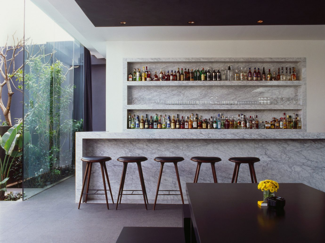 artistic artsy Bar bar seating chic cozy Greenery Hip Hotels Luxury Modern trendy view windows indoor floor room house wall Architecture interior design home living room Design wood window covering ceiling furniture