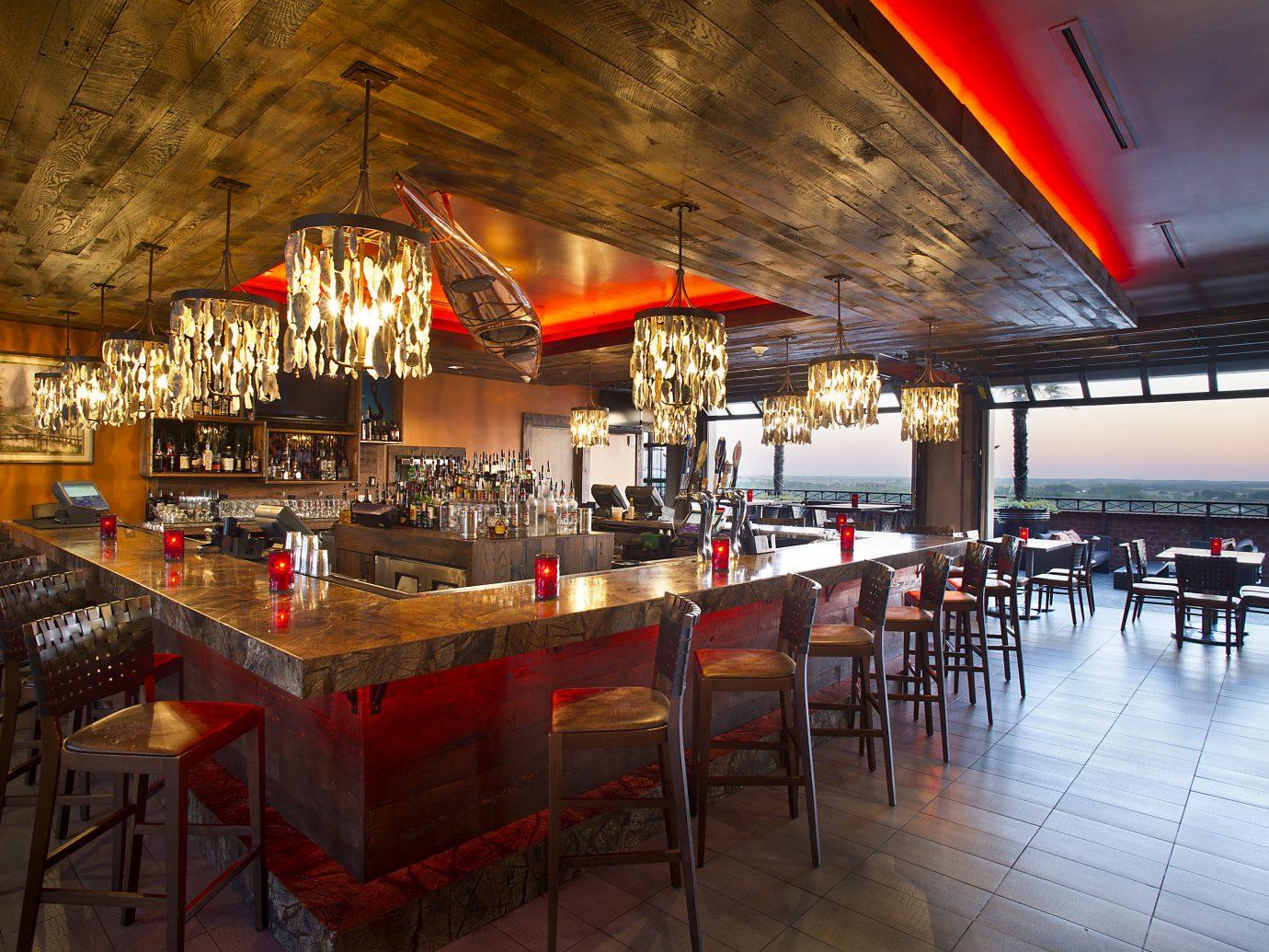 Boutique Hotels Food + Drink Girls Getaways Weekend Getaways table floor indoor chair ceiling restaurant interior design Bar Dining café area several