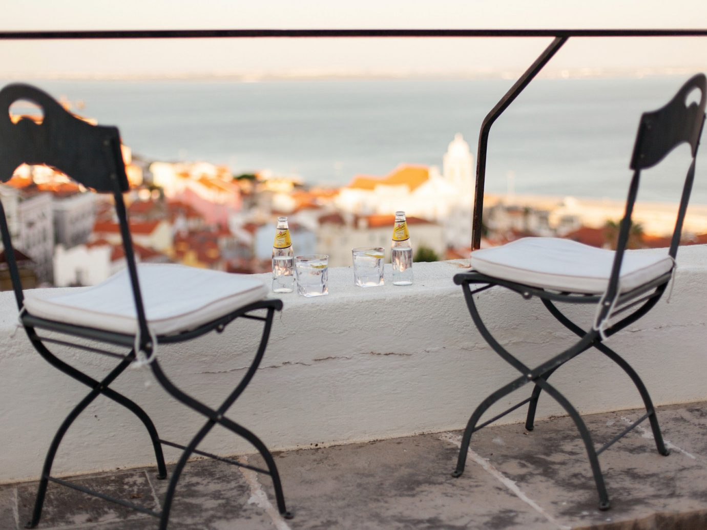 Balcony Buildings City city views Drink drinks lounge chairs Ocean ocean view Patio private serene Terrace Trip Ideas view sky color outdoor furniture table wood set