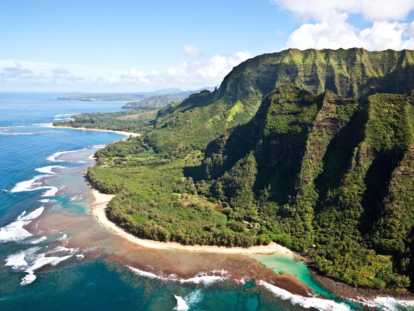 Beachfront Ocean Trip Ideas Tropical mountain sky Nature water outdoor Coast geographical feature landform cliff body of water Sea vacation terrain bay cape landscape fjord cove aerial photography hillside