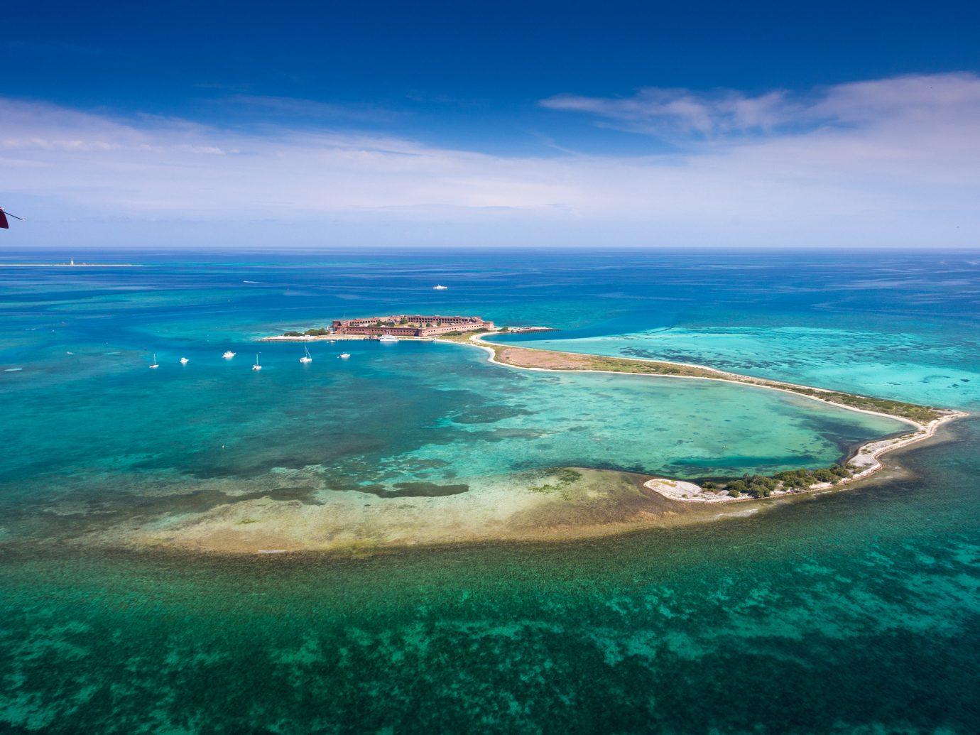 water sky Ocean outdoor Sea Nature geographical feature landform blue horizon Coast reef archipelago caribbean islet wind wave shore Island cape wave Beach atoll bay Lagoon swimming