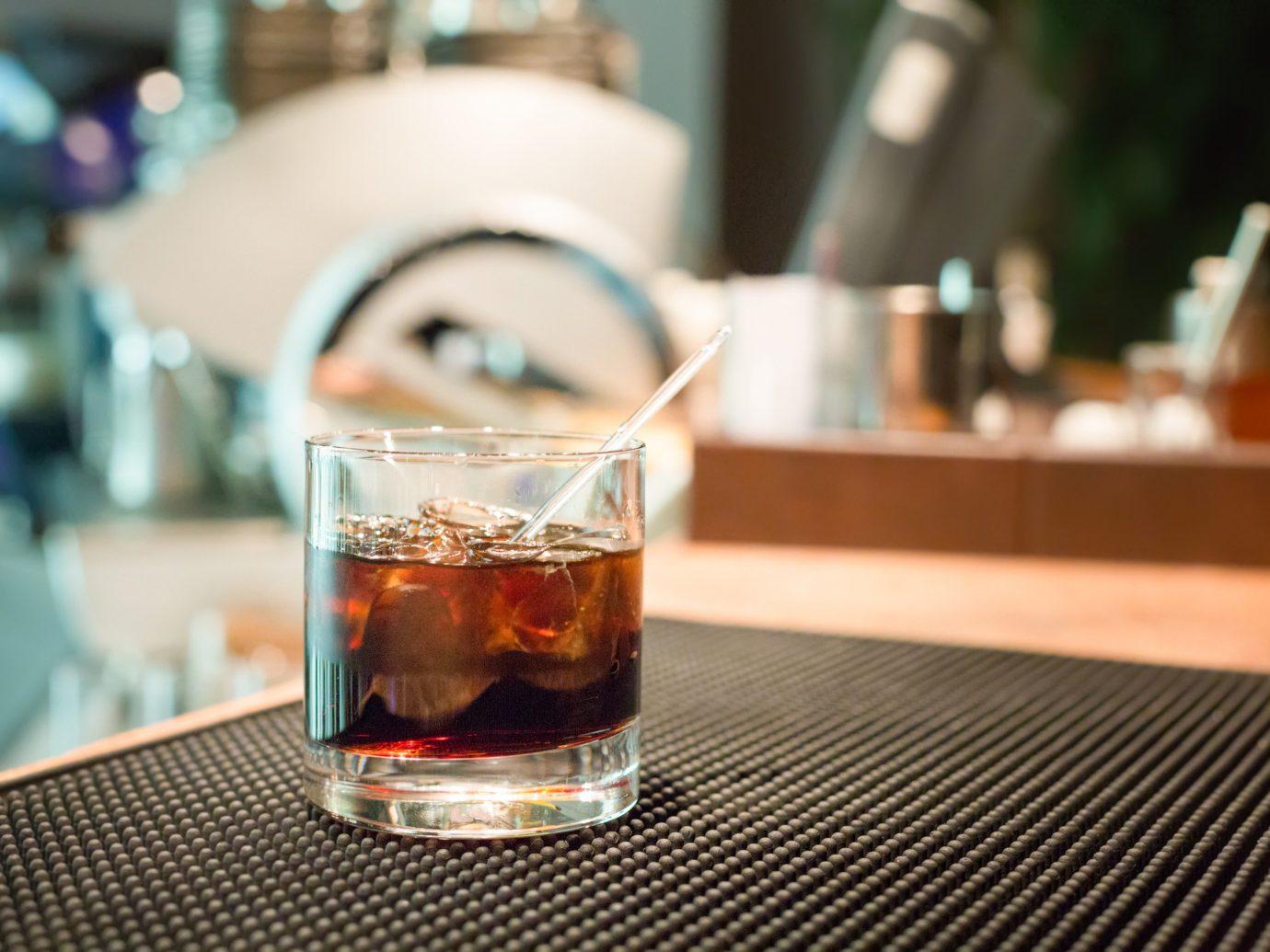 Food + Drink Trip Ideas table Drink indoor alcoholic beverage glass alcohol beverage distilled beverage beer restaurant sense whisky Bar cocktail