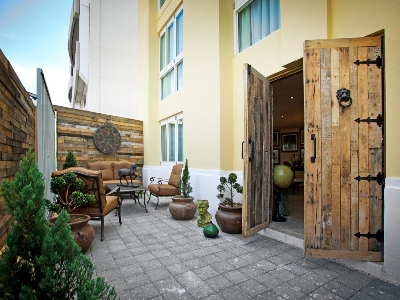 Exterior Hotels Lounge Patio Rustic property room house estate home Courtyard cottage real estate facade interior design furniture stone