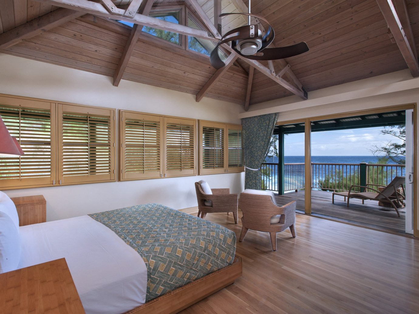 Balcony Beach bed Bedroom Boutique Hotels charming Hotels interior lounge chairs Luxury Luxury Travel Ocean ocean view quaint remote Rustic indoor floor room ceiling property house estate home Living real estate interior design living room cottage furniture wood Design condominium Villa area