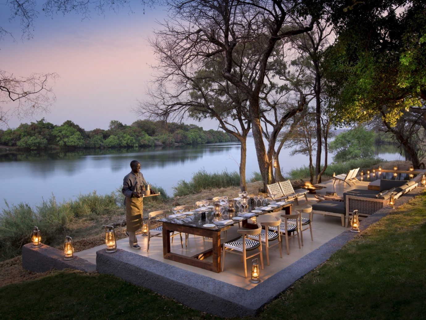 Hotels Outdoors + Adventure Travel Tips tree outdoor water sky grass River park Lake estate pond