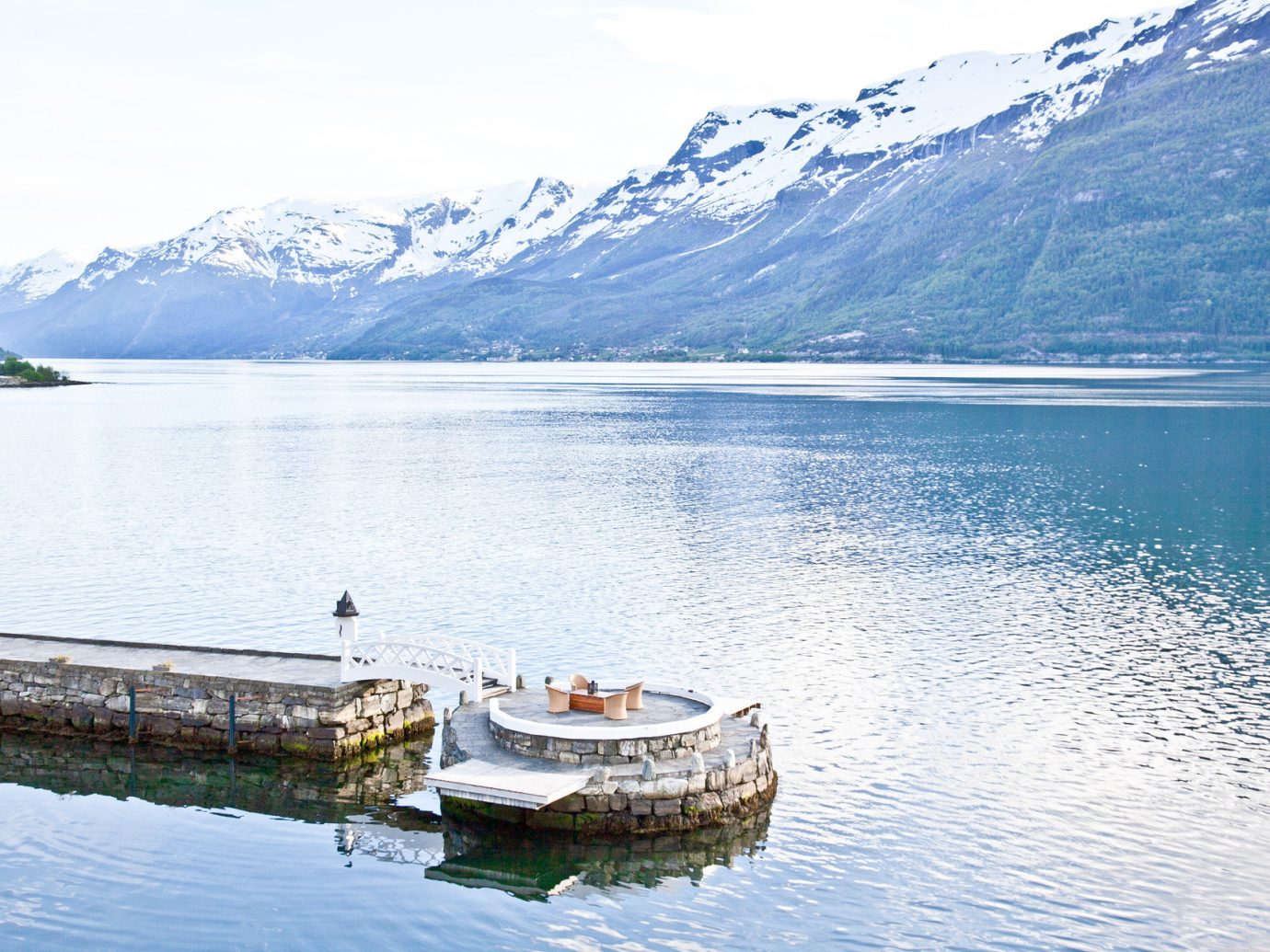dock Mountains Nature Outdoors River Scenic views snow capped Mountains Trip Ideas view viewpoint water mountain Boat outdoor Lake fjord vehicle reflection loch reservoir Sea bay mountain range glacial landform distance