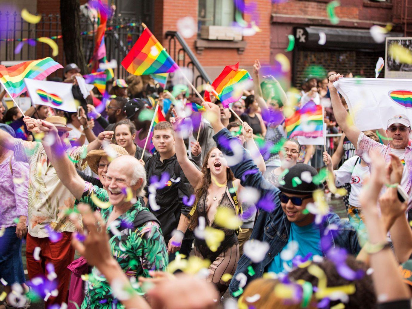 Trip Ideas person carnival event festival colorful pride parade parade dance crowd colored