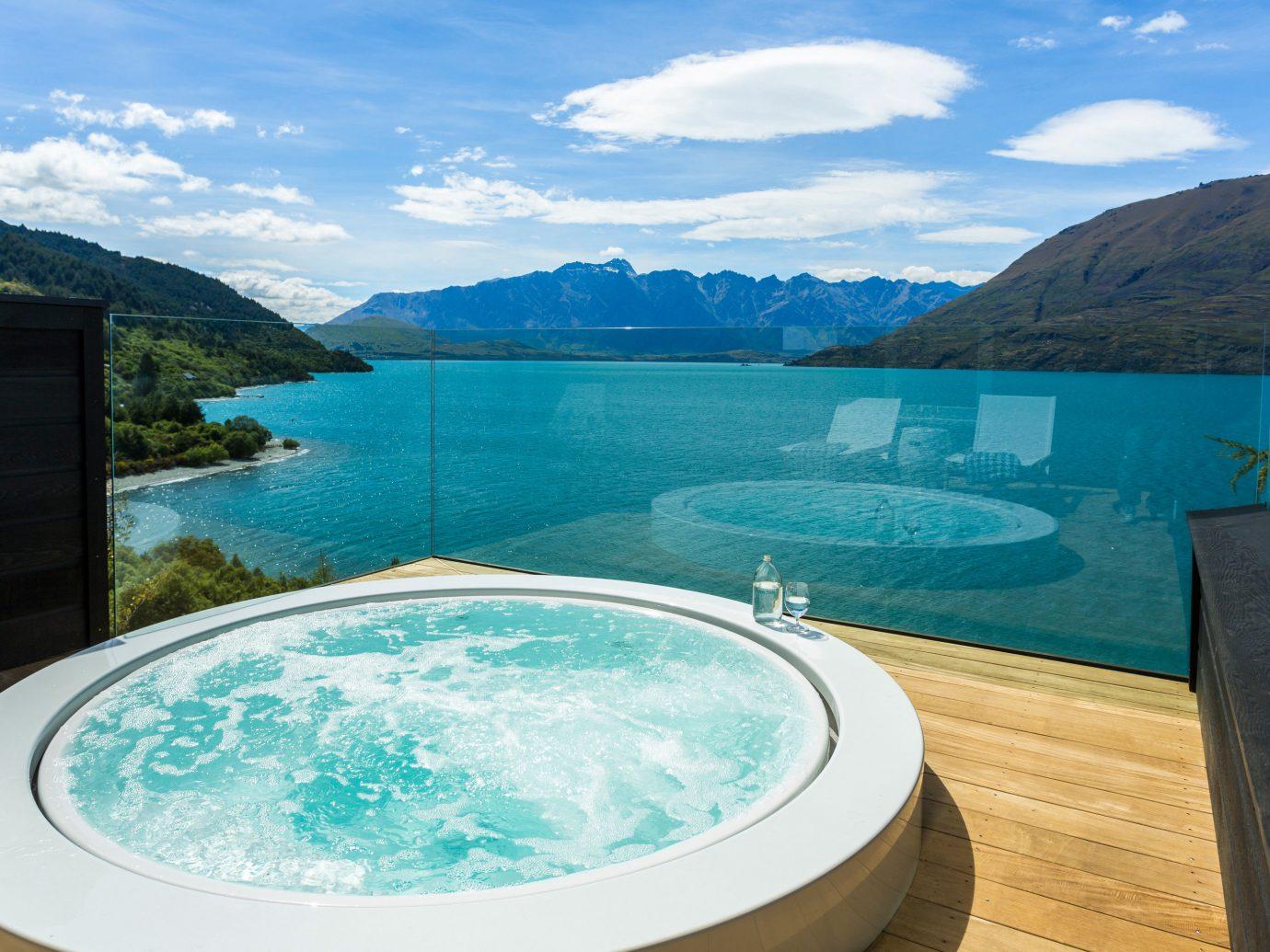 mountain sky water swimming pool overlooking Lake Nature Lagoon shore swimming