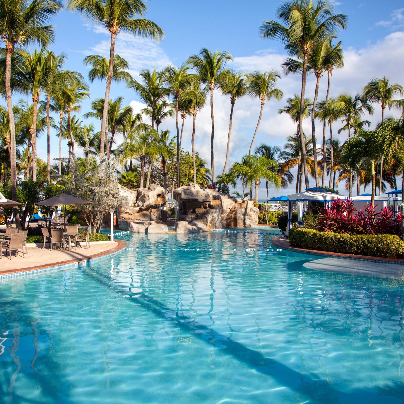 Outdoors Play Pool Resort tree water sky swimming pool leisure palm swimming caribbean resort town Lagoon arecales Sea Water park lined surrounded