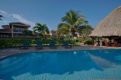 sky water swimming pool Pool property Resort leisure house resort town caribbean Lagoon condominium Villa outdoor object swimming
