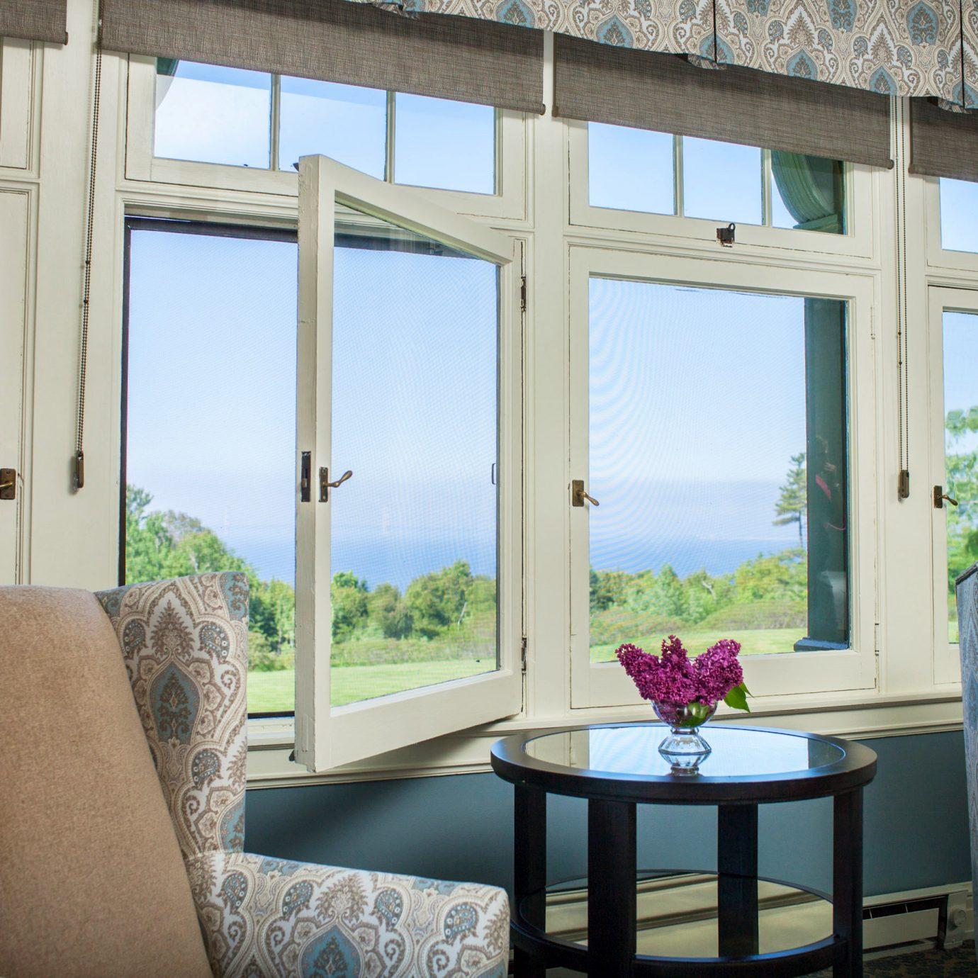 Lounge Scenic views sofa property living room home house porch cottage condominium window treatment curtain Villa seat