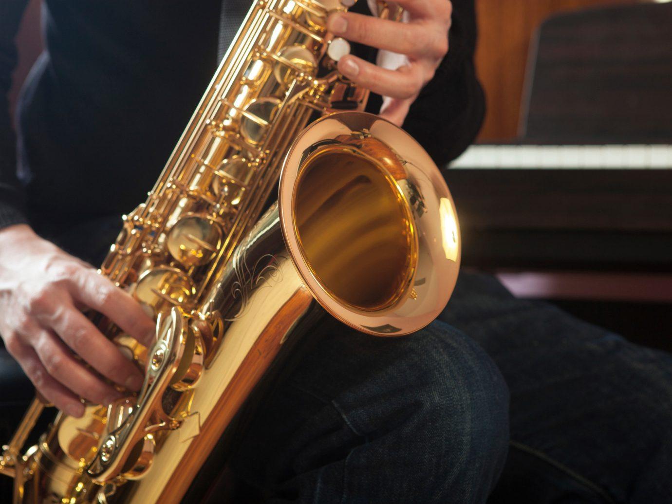 Trip Ideas person Music saxophone saxophonist indoor slide guitar brass musical instrument string instrument baritone saxophone woodwind instrument bassist euphonium tuba brass instrument wind instrument bass guitar reed instrument jazz guitar sax