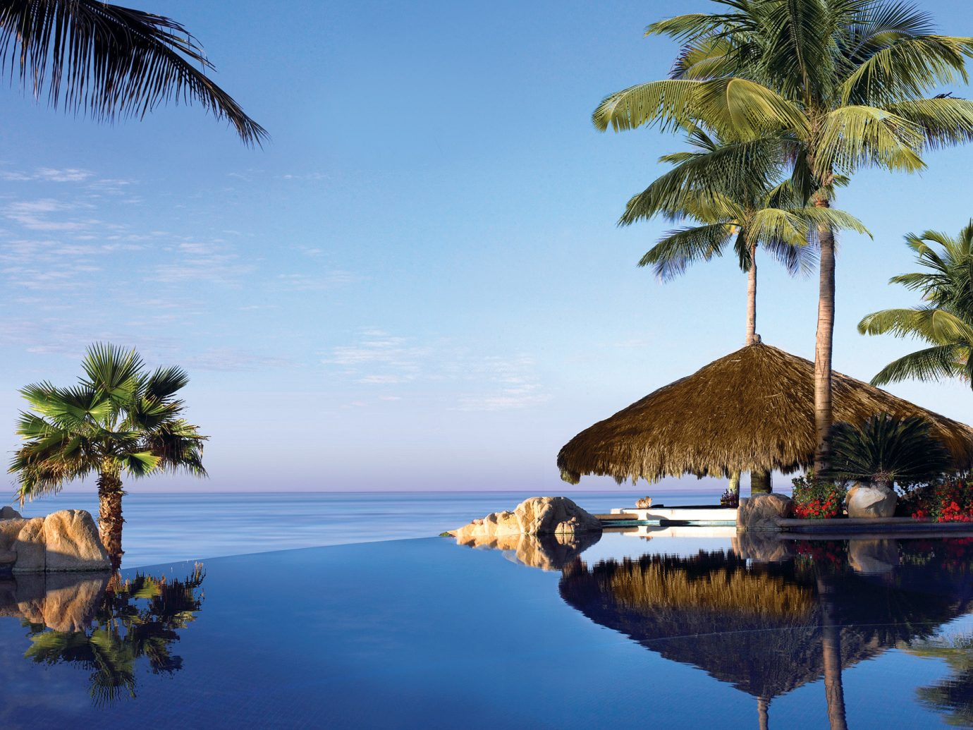 Beachfront Hotels Play Pool Resort Romance Scenic views tree water outdoor sky Sea Beach Ocean Coast body of water shore Lake vacation palm family palm plant caribbean tropics arecales bay woody plant reflection Island Lagoon cape islet dusk cove flower overlooking shade surrounded