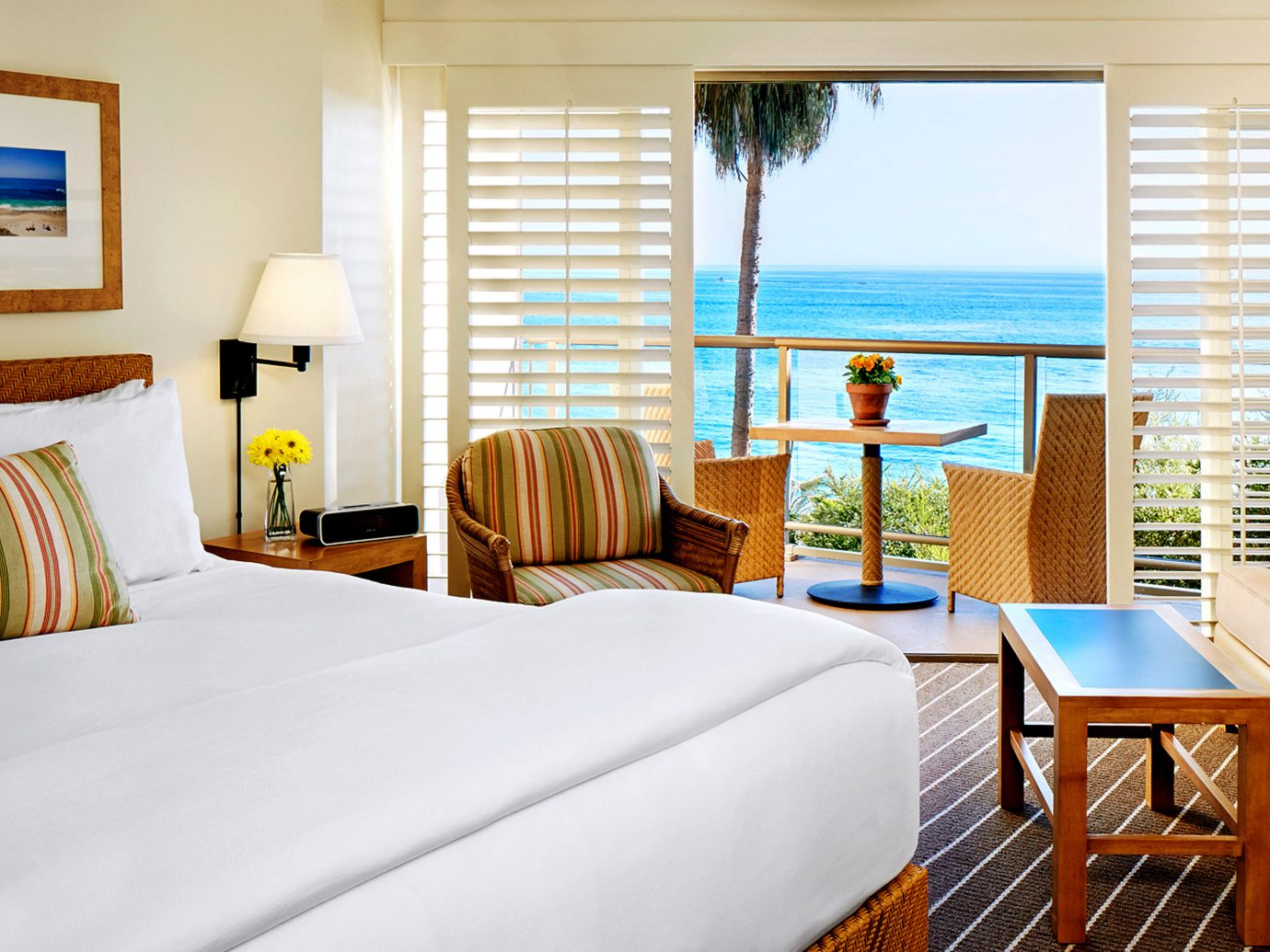 Balcony Beachfront Bedroom Classic Hotels Inn Living Scenic views Weekend Getaways indoor room wall sofa floor window bed hotel property chair Suite estate cottage real estate interior design white Resort home furniture nice apartment Villa decorated area Modern clean