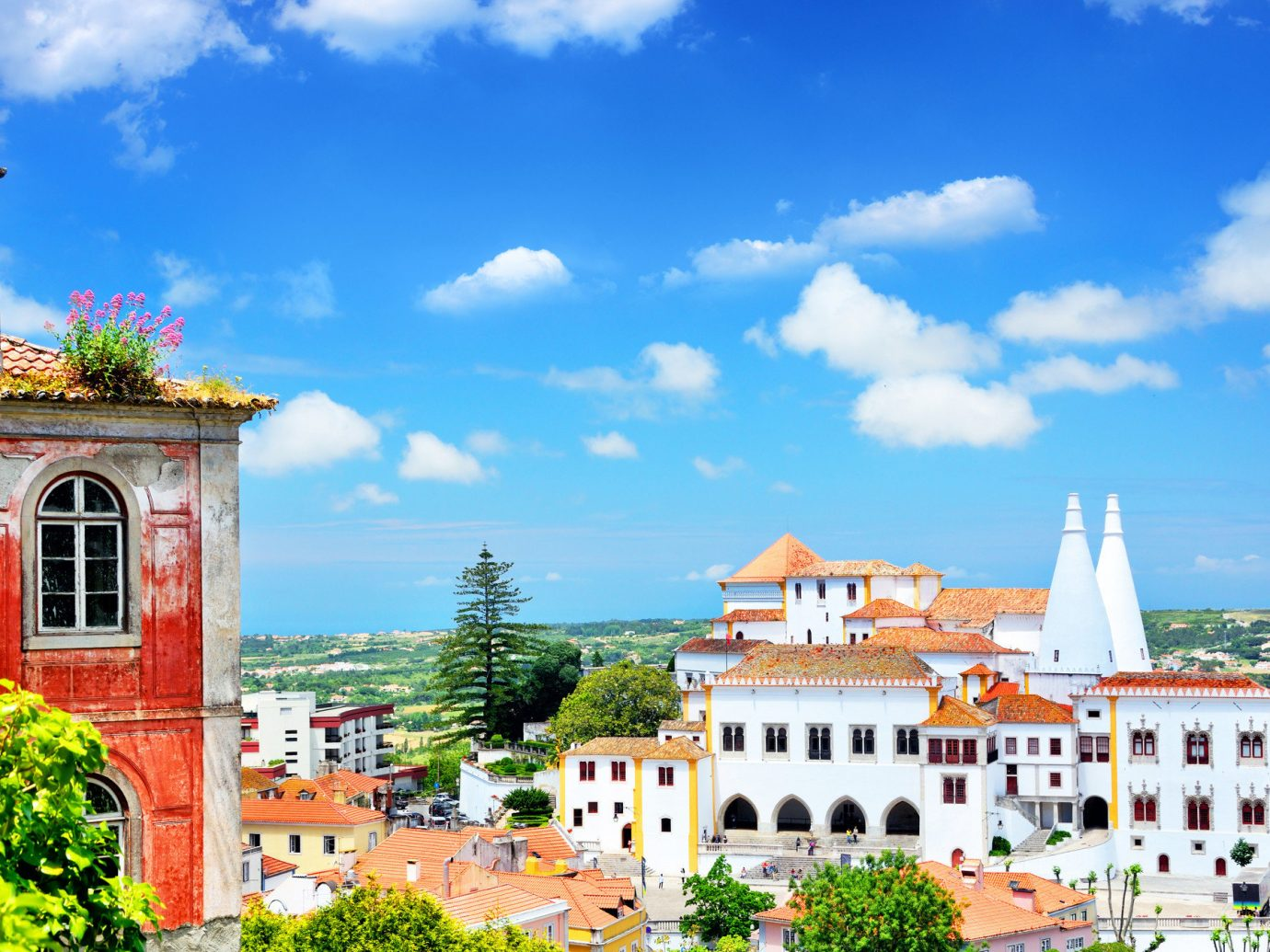Trip Ideas sky outdoor building Town landmark City human settlement neighbourhood tourism vacation estate cityscape residential area white Village tower palace stone surrounded