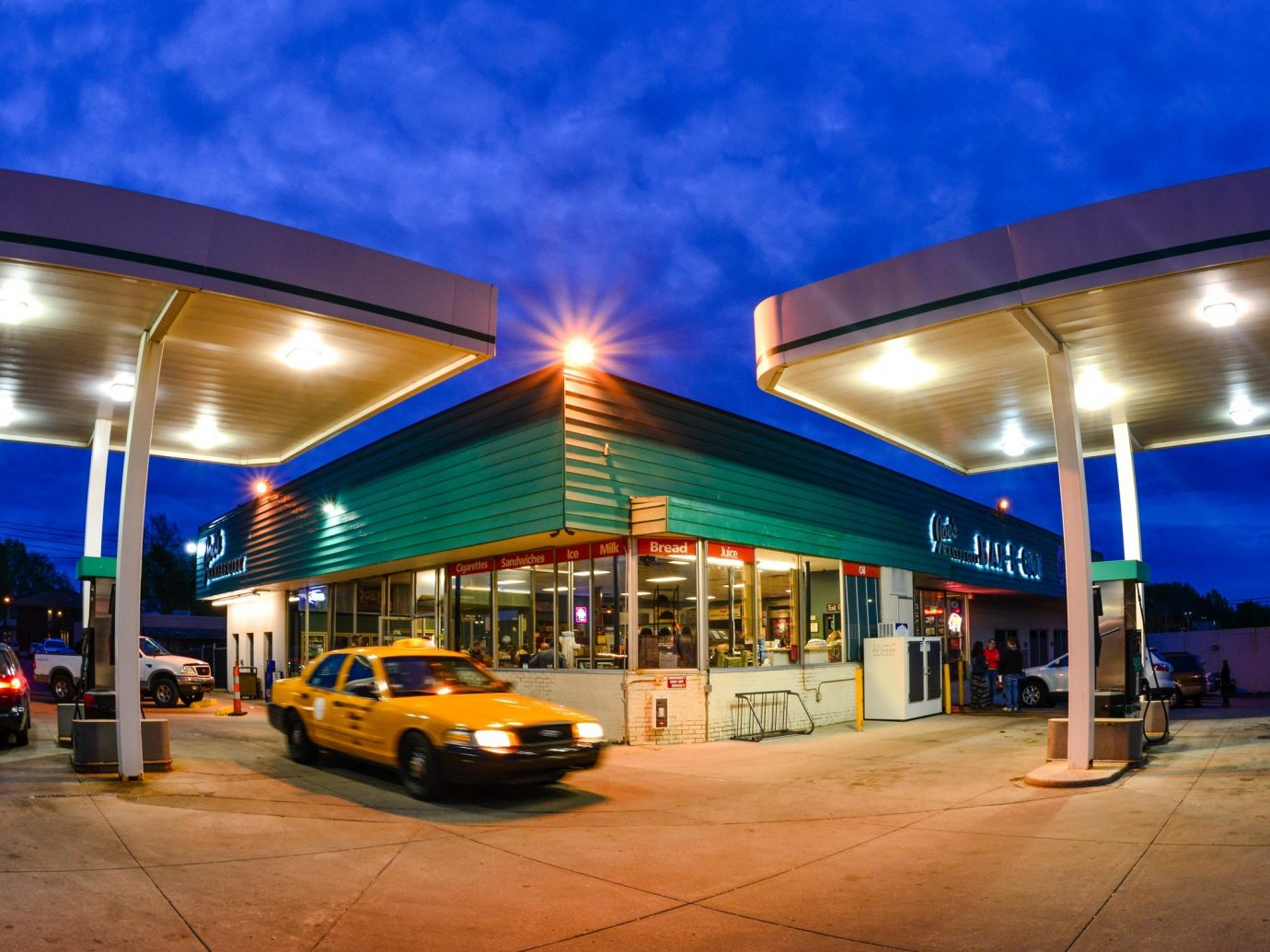 City Kansas City Midwest Trip Ideas sky outdoor filling station mixed use real estate night building evening sign