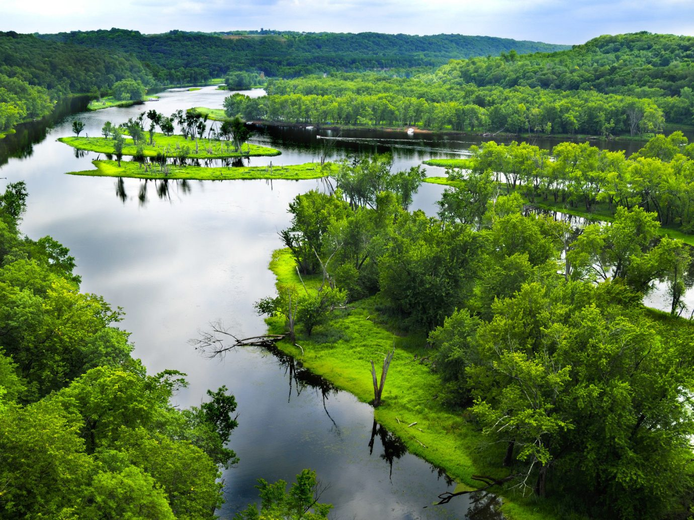 Trip Ideas tree outdoor sky water habitat Nature River nature reserve reflection Lake wilderness body of water ecosystem tarn loch green Forest fjord reservoir landscape wetland pond stream mountain range aerial photography bushes traveling hillside surrounded land