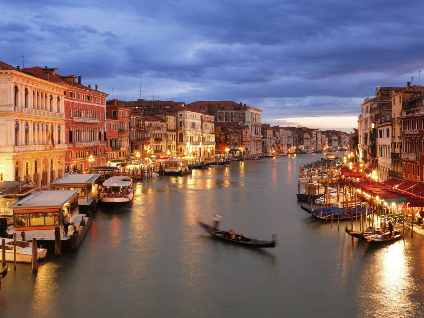 Hotels building sky scene water outdoor Boat Harbor geographical feature Town body of water cityscape Canal River waterway evening channel full reflection Sea dusk vehicle Sunset several