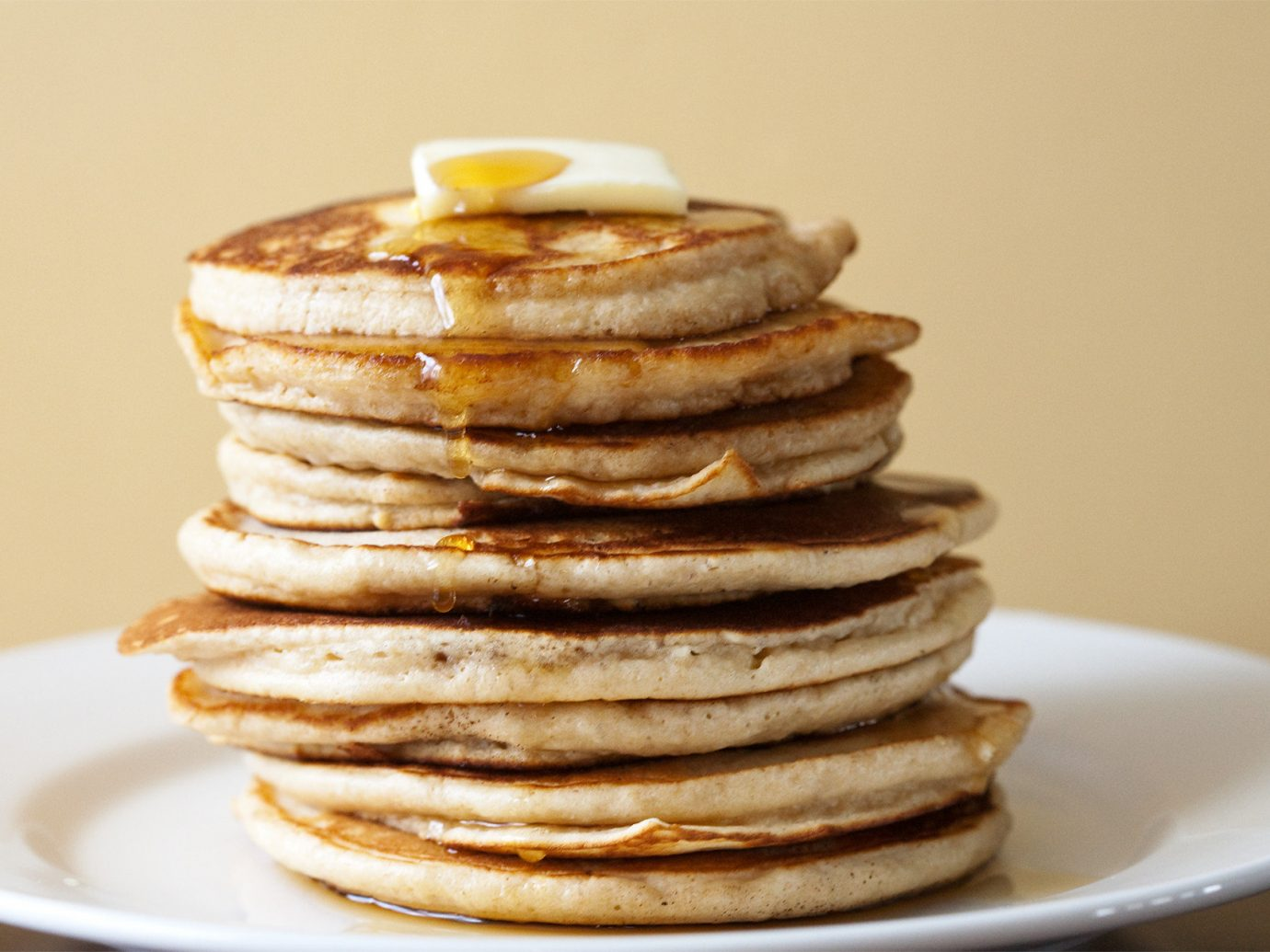 Food + Drink plate table food dish meal indoor breakfast pancake white dessert produce flavor cuisine stack stacked sliced