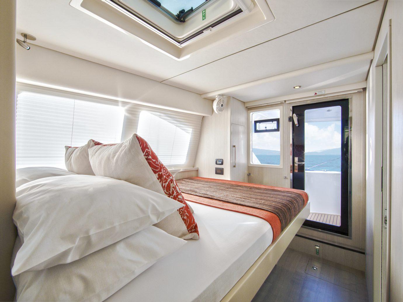 Trip Ideas indoor bed room window Bedroom white real estate Cabin Suite interior design