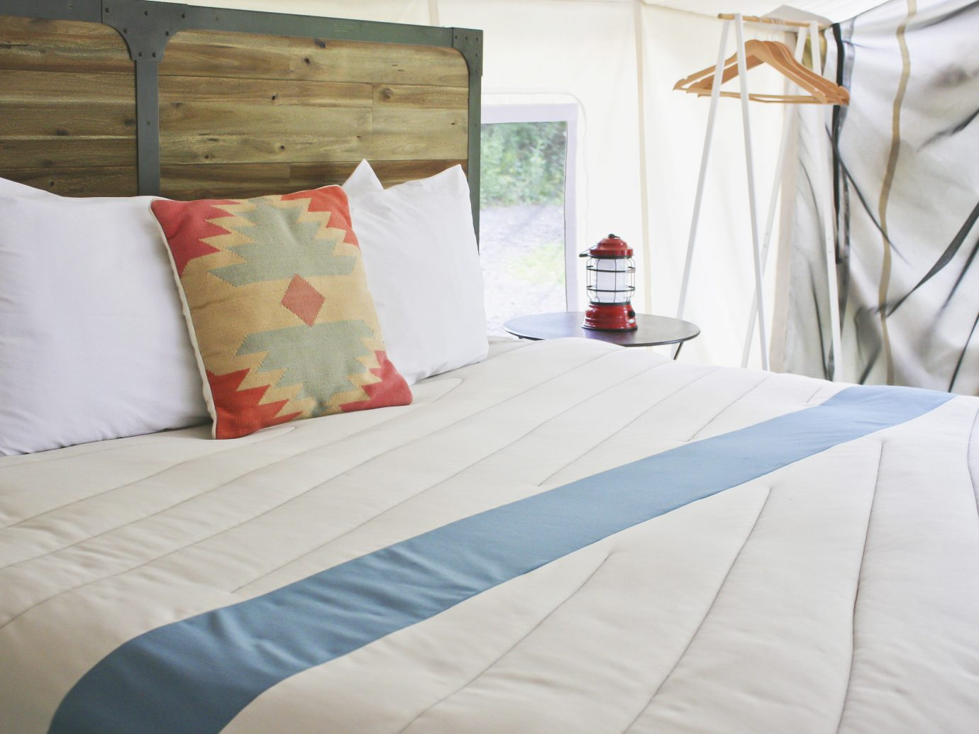 Glamping Luxury Travel Trip Ideas bed indoor bed sheet pillow room Bedroom duvet cover bedding bed frame textile home mattress linens furniture floor interior design Suite cushion hotel bedclothes mattress pad product comfort window