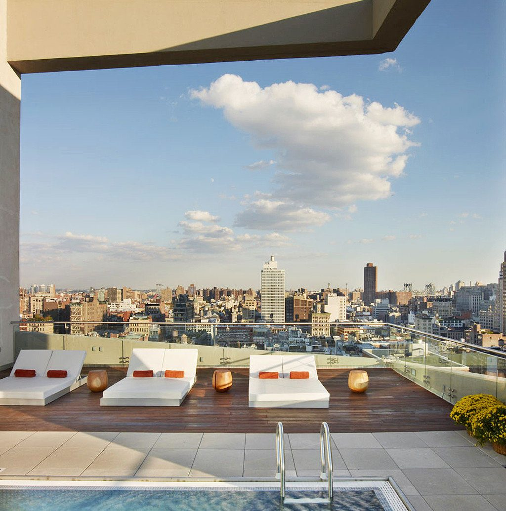 Boutique City Hotels Lounge Modern Pool Rooftop sky outdoor landmark Architecture vacation plaza condominium facade Resort day