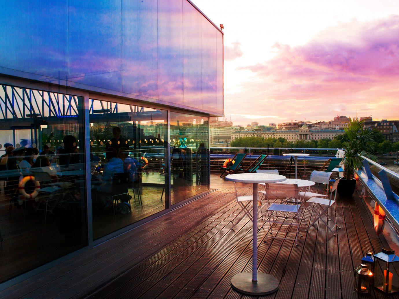 Arts + Culture sky outdoor reflection urban area Architecture vacation evening cityscape waterway dock Sunset dusk vehicle marina